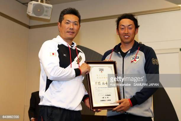 Hiroki Kokubo and Yoshihisa Hirano of Samurai Japan players during the training camp team meeting ahead of the World Baseball Classic 2017 on...