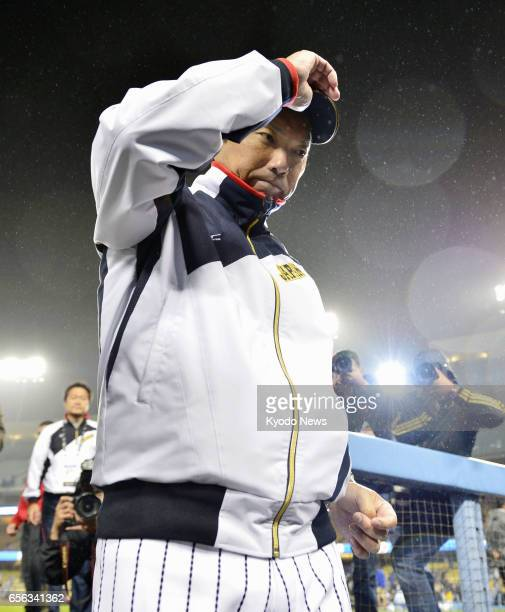 Hiroki Kokubo Japan's World Baseball Classic manager leaves the dugout after his team lost to the United States 21 in the semifinals at Dodger...