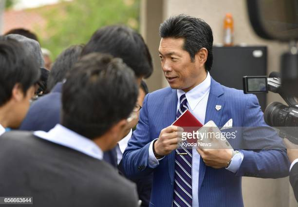 Hiroki Kokubo manager of Japan's World Baseball Classic team meets with reporters in front of a Los Angeles hotel on March 22 before returning home...