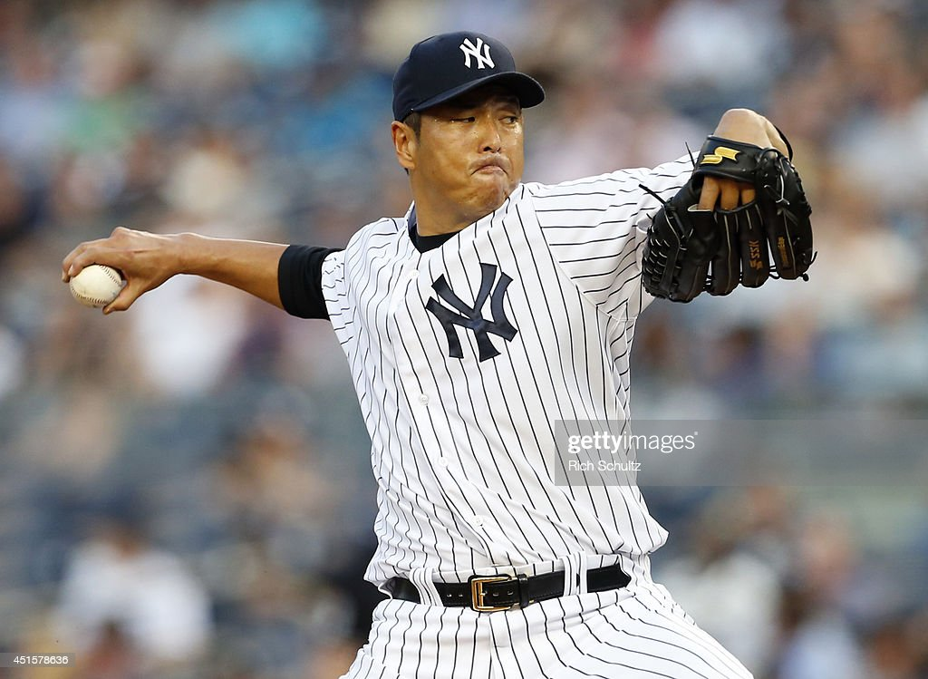 <a gi-track='captionPersonalityLinkClicked' href=/galleries/search?phrase=Hiroki+Kuroda&family=editorial&specificpeople=5498664 ng-click='$event.stopPropagation()'>Hiroki Kuroda</a> #18 delivers a pitch against the Tampa Bay Rays during the second inning in a MLB baseball game at Yankee Stadium on July 1, 2014 in the Bronx borough of New York City.