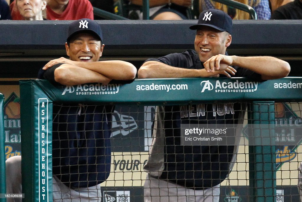 Hiroki Kuroda #18, left, and Derek Jeter #2 of the New York Yankees joke in the dugout during the sixth inning against the Houston Astros on September 29, 2013 at Minute Maid Park in Houston, TX.