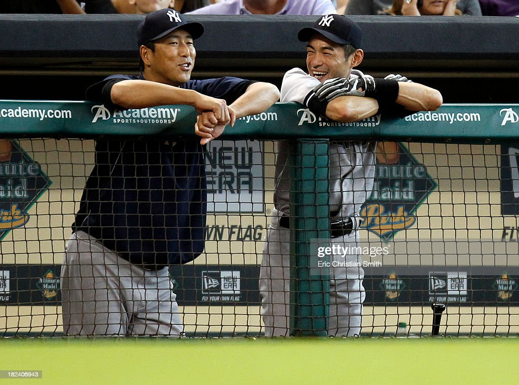 Hiroki Kuroda #18, left, and Ichiro Suzuki #31 of the New York Yankees talk in the dugout during the seventh inning against the Houston Astros on September 29, 2013 at Minute Maid Park in Houston, TX.