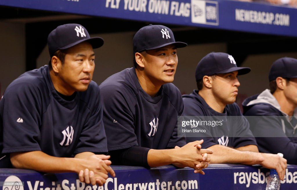Hiroki Kuroda Masahiro Tanaka and Mark Teixeira look on from the dugout before the start of a game against the Tampa Bay Rays on September 16 2014 at...