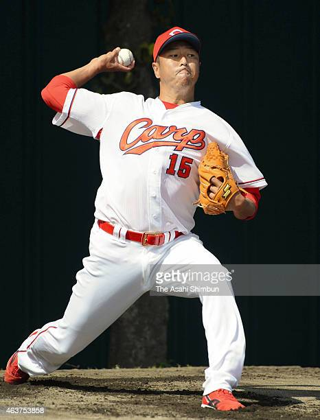Hiroki Kuroda of Hiroshima Toyo Carp throws in the bullpen during the spring camp at the Koza Shinkin Stadium on February 18 2015 in Okinawa Japan...