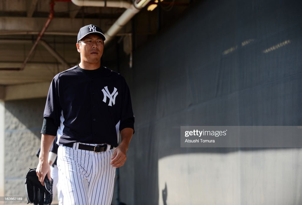 Hiroki Kuroda #18 of New York Yankees looks on during the New York Yankees spring training on February 25, 2013 in Tampa, Florida.