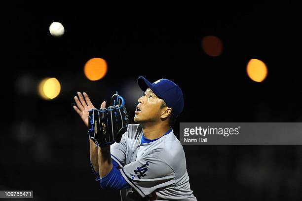 Hiroki Kuroda of the Los Angeles Dodgers catches a pop up against the Cincinnati Reds at Goodyear Ballpark on March 3 2011 in Goodyear Arizona