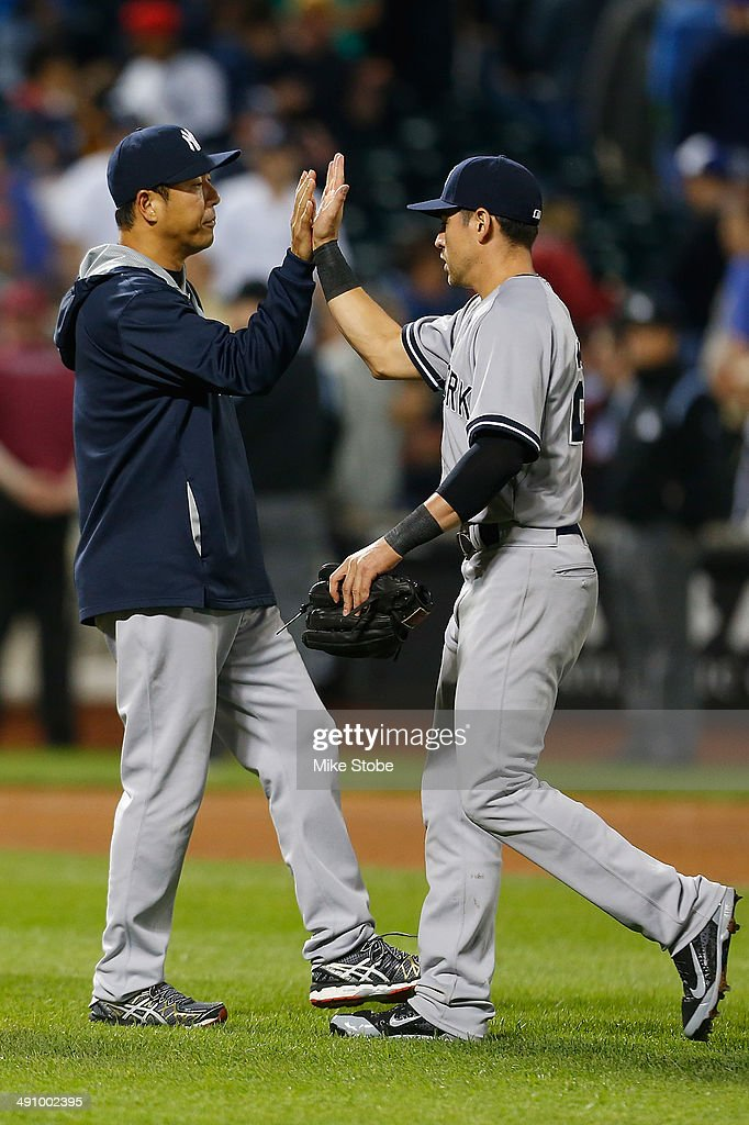 Hiroki Kuroda of the New York Yankees celebrates with Jacoby Ellsbury after defeating the New York Mets on May 15 2014 at Citi Field in the Flushing...