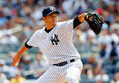 Hiroki Kuroda of the New York Yankees delivers a first inning pitch against the Boston Red Sox at Yankee Stadium on April 12 2014 in the Bronx...