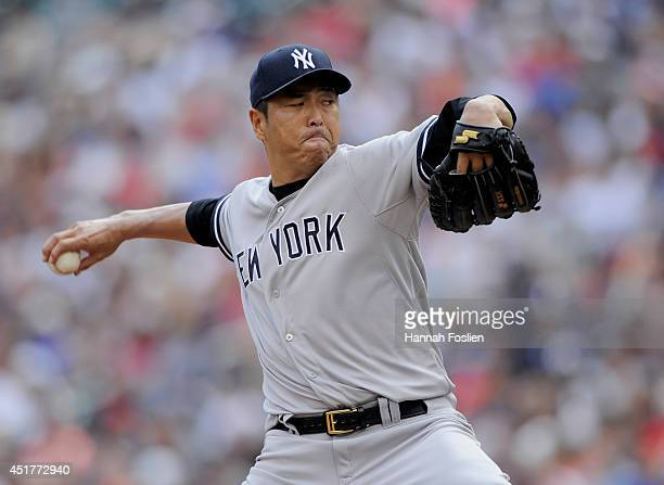 Hiroki Kuroda of the New York Yankees delivers a pitch against the Minnesota Twins during the first inning of the game on July 6 2014 at Target Field...