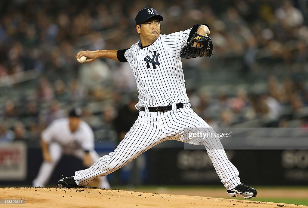 Hiroki Kuroda #18 of the New York Yankees delivers a pitch in the first inning against the Boston Red Sox on October 3, 2012 at Yankee Stadium in the Bronx borough of New York City.