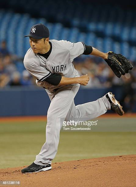 Hiroki Kuroda of the New York Yankees delivers a pitch in the first inning during MLB game action against the Toronto Blue Jays on June 25 2014 at...