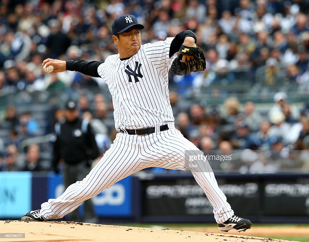 Hiroki Kuroda of the New York Yankees delivers a pitch in the first inning against the Baltimore Orioles during the home opener on April 7 2014 at...