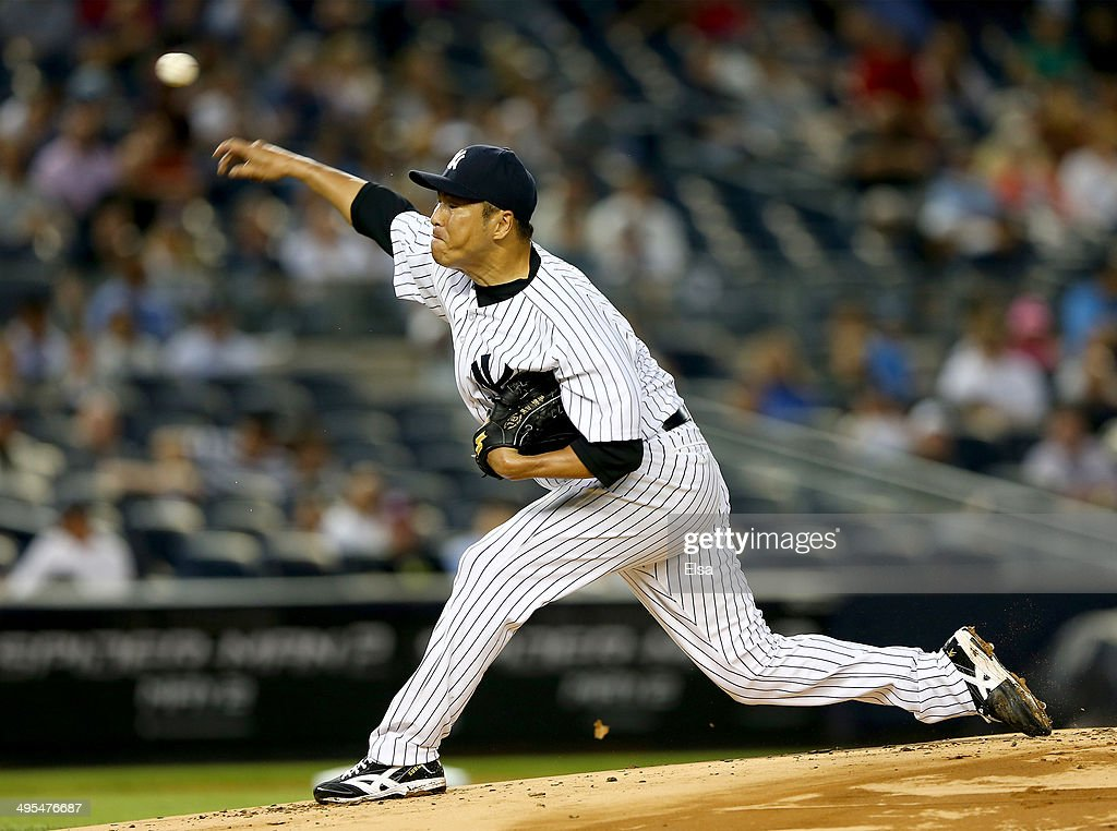 Hiroki Kuroda of the New York Yankees delivers a pitch in the first inning against the Oakland Athletics on June 3 2014 at Yankee Stadium in the...