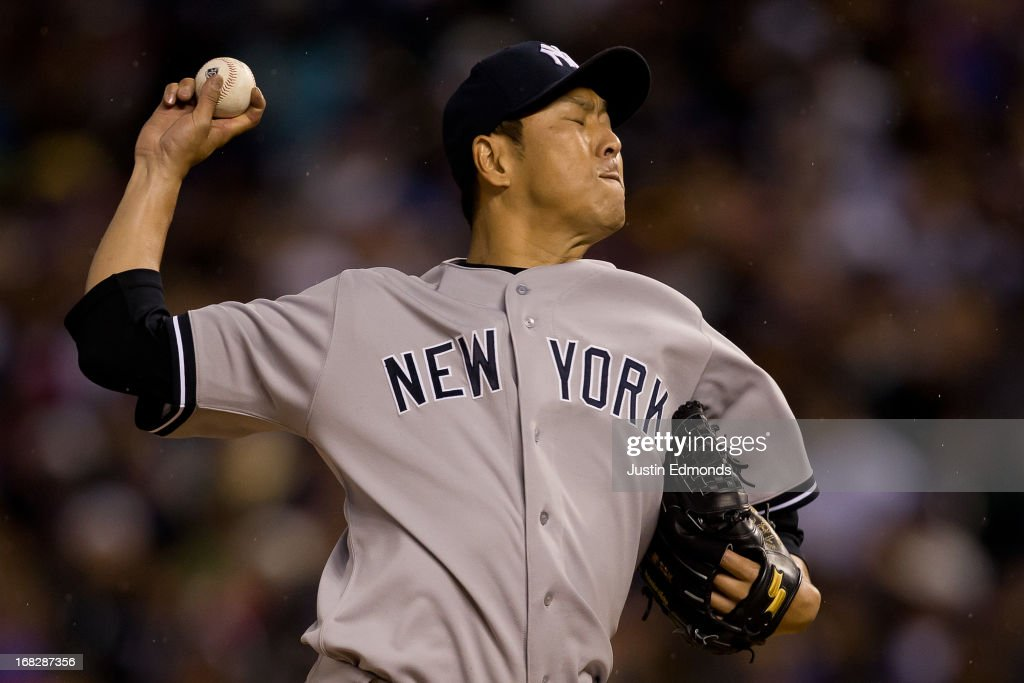 Hiroki Kuroda #18 of the New York Yankees delivers to home plate during the third inning against the Colorado Rockies at Coors Field on May 7, 2013 in Denver, Colorado.