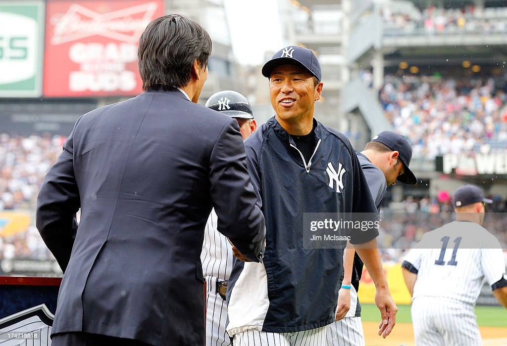 Hiroki Kuroda #18 of the New York Yankees greets former New York Yankee Hideki Matsui after a pre game ceremony honoring Matsui prior to a game against the Tampa Bay Rays at Yankee Stadium on July 28, 2013 in the Bronx borough of New York City.