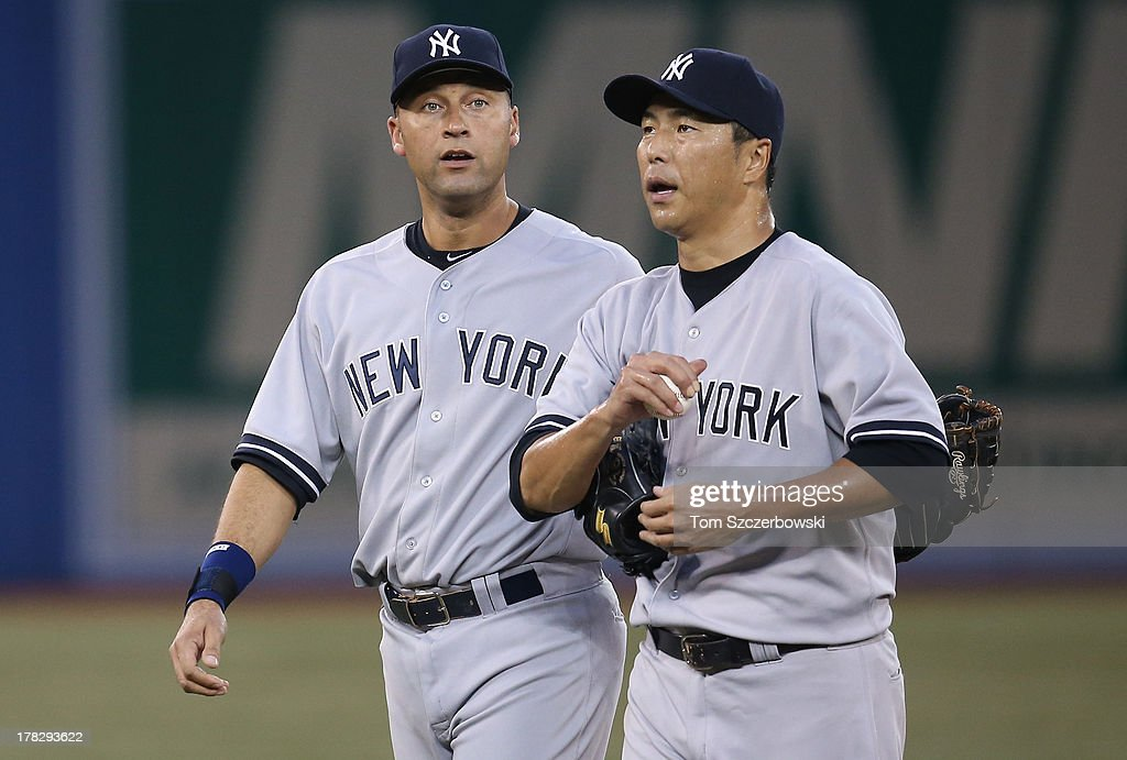 <a gi-track='captionPersonalityLinkClicked' href=/galleries/search?phrase=Hiroki+Kuroda&family=editorial&specificpeople=5498664 ng-click='$event.stopPropagation()'>Hiroki Kuroda</a> #18 of the New York Yankees is consoled by <a gi-track='captionPersonalityLinkClicked' href=/galleries/search?phrase=Derek+Jeter&family=editorial&specificpeople=167125 ng-click='$event.stopPropagation()'>Derek Jeter</a> #2 after giving up a multi-run inning during MLB game action against the Toronto Blue Jays on August 28, 2013 at Rogers Centre in Toronto, Ontario, Canada.
