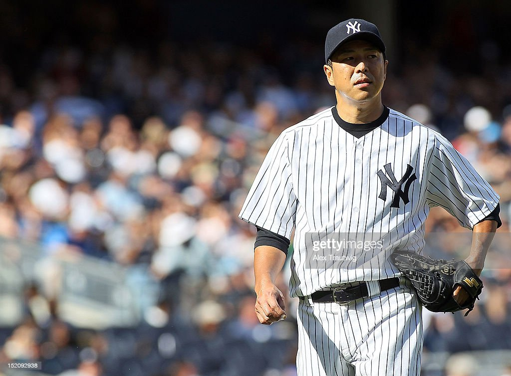 <a gi-track='captionPersonalityLinkClicked' href=/galleries/search?phrase=Hiroki+Kuroda&family=editorial&specificpeople=5498664 ng-click='$event.stopPropagation()'>Hiroki Kuroda</a> #18 of the New York Yankees looks on against the Tampa Bay Rays at Yankee Stadium on September 16, 2012 in the Bronx borough of New York City.
