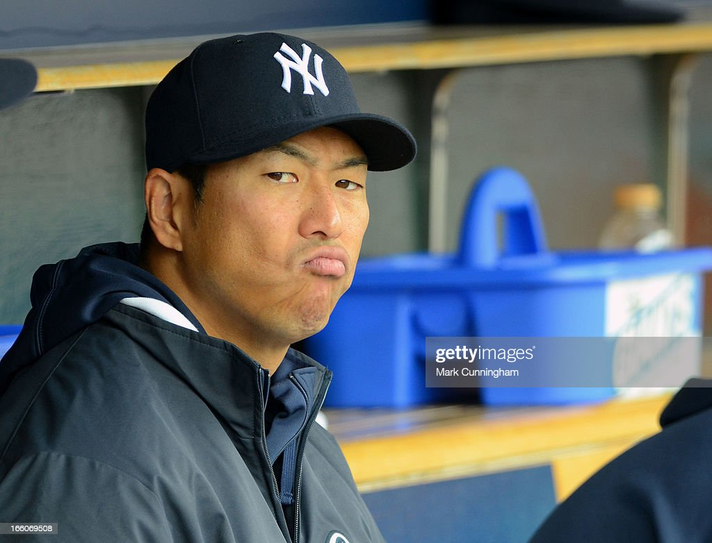 Hiroki Kuroda #18 of the New York Yankees looks on from the dugout during the game against the Detroit Tigers at Comerica Park on April 7, 2013 in Detroit, Michigan. The Yankees defeated the Tigers 7-0.