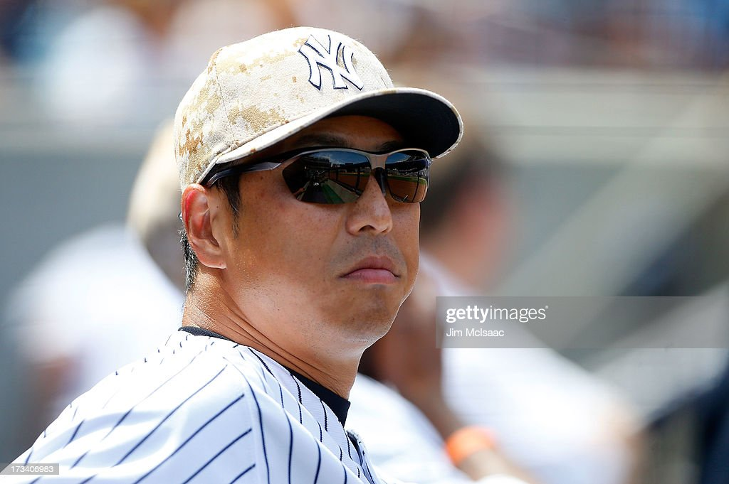 Hiroki Kuroda #18 of the New York Yankees looks on from the dugout against the Minnesota Twins at Yankee Stadium on July 13, 2013 in the Bronx borough of New York City.