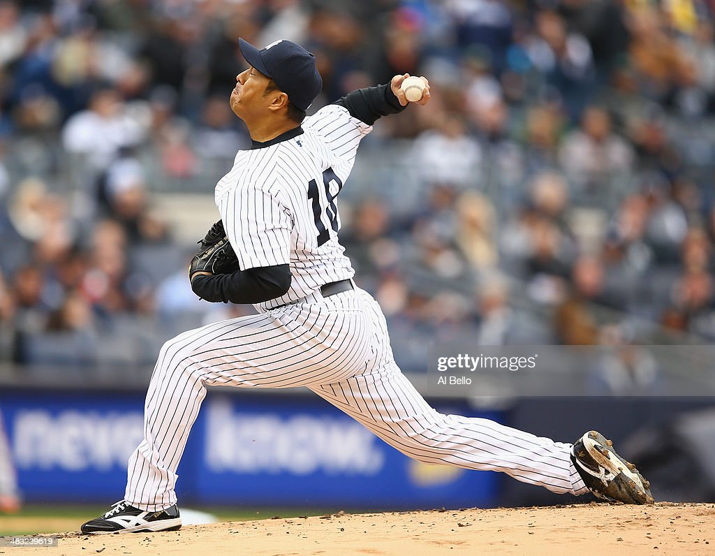 Hiroki Kuroda of the New York Yankees pitches against the Baltimore Orioles during their game on April 7 2014 at Yankee Stadium in the Bronx borough...