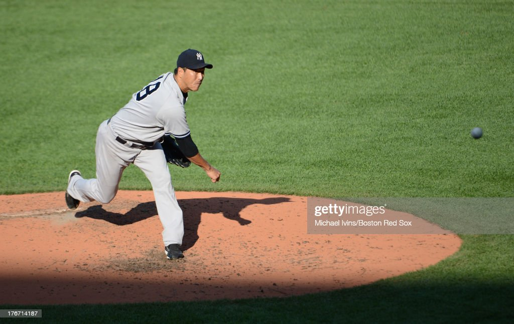Hiroki Kuroda #18 of the New York Yankees pitches against the Boston Red Sox during the fourth inning on August 17, 2013 at Fenway Park in Boston Massachusetts.