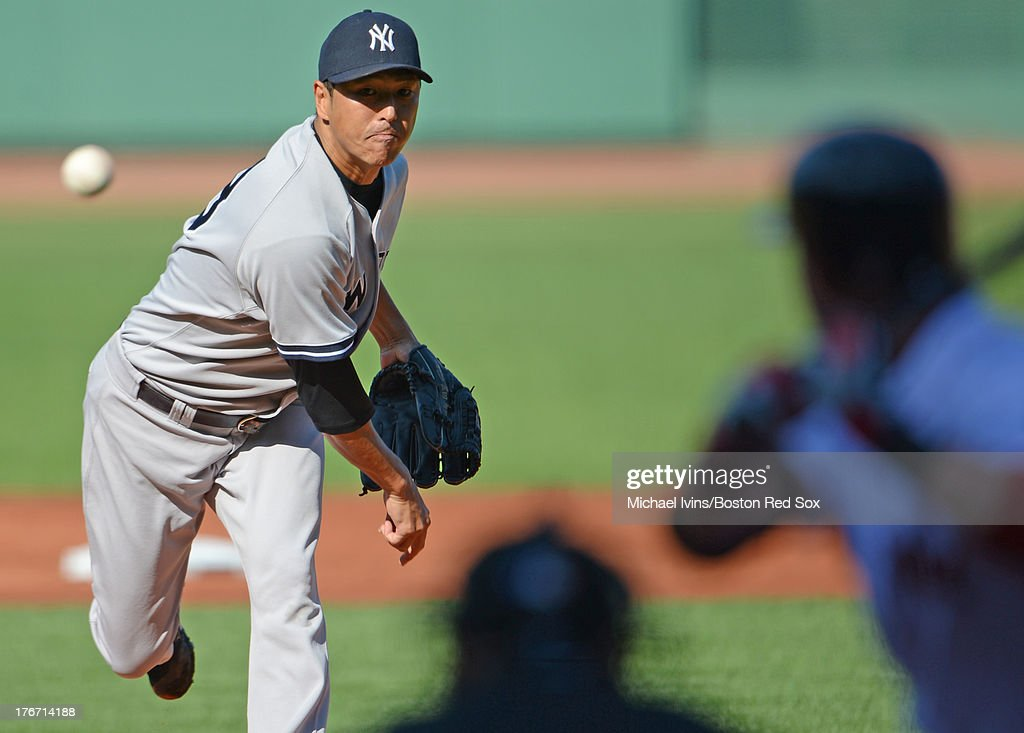 Hiroki Kuroda #18 of the New York Yankees pitches against the Boston Red Sox during the first inning on August 17, 2013 at Fenway Park in Boston Massachusetts.