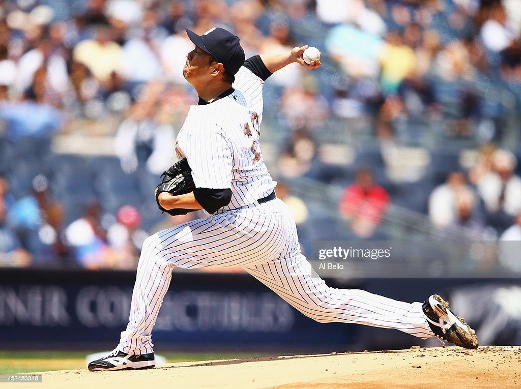 Hiroki Kuroda of the New York Yankees pitches against the Cincinnati Reds during their game at Yankee Stadium on July 19 2014 in the Bronx borough of...