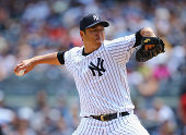 Hiroki Kuroda of the New York Yankees pitches against the Cleveland Indians during their game at Yankee Stadium on August 10 2014 in the Bronx...