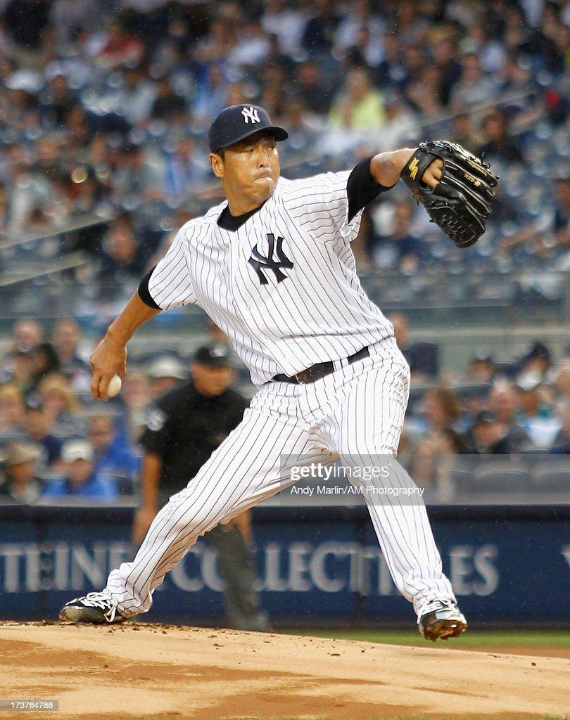 Hiroki Kuroda #18 of the New York Yankees pitches against the Minnesota Twins at Yankee Stadium on July 12, 2013 in the Bronx borough of New York City.