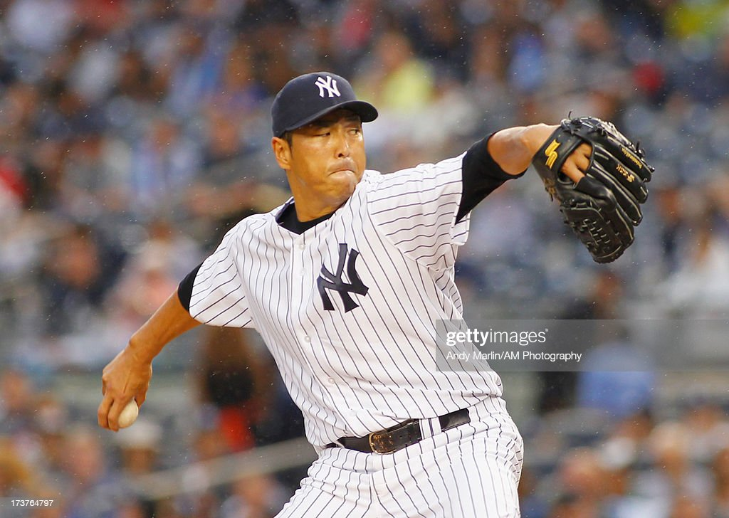 Hiroki Kuroda #18 of the New York Yankees pitches against the Minnesota Twins at Yankee Stadium on July 12, 2013 in the Bronx borough of New York City.