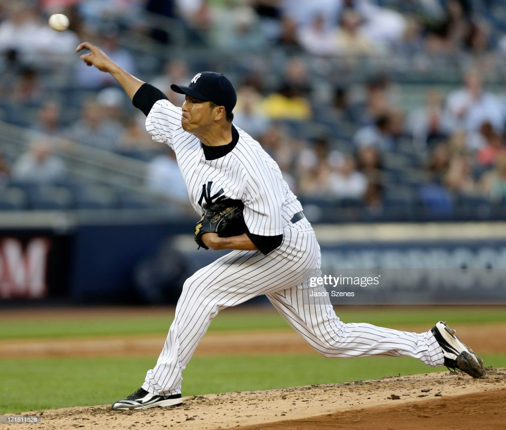 <a gi-track='captionPersonalityLinkClicked' href=/galleries/search?phrase=Hiroki+Kuroda&family=editorial&specificpeople=5498664 ng-click='$event.stopPropagation()'>Hiroki Kuroda</a> #18 of the New York Yankees pitches against the Texas Rangers at Yankee Stadium on June 25, 2013 in the Bronx borough of New York City.