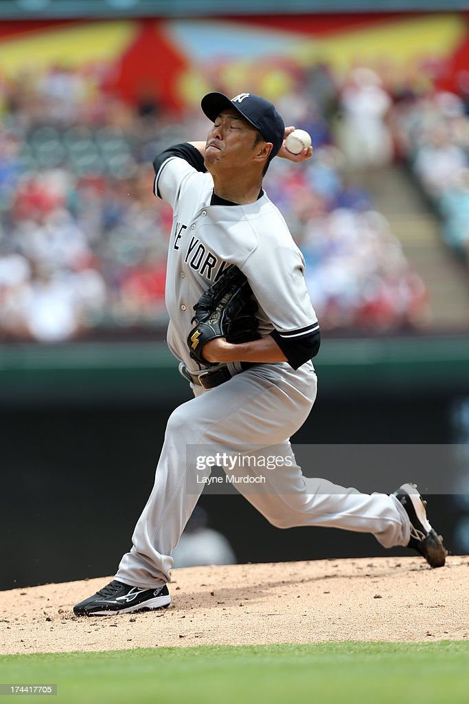 Hiroki Kuroda #18 of the New York Yankees pitches against the Texas Rangers on July 25, 2013 at the Rangers Ballpark in Arlington in Arlington, Texas.