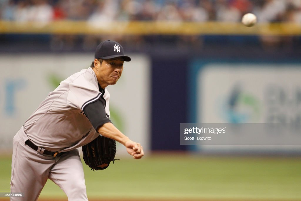 Hiroki Kuroda #18 of the New York Yankees pitches during the first inning against the Tampa Bay Rays at Tropicana Field on August 17, 2014 in St Petersburg, Florida.