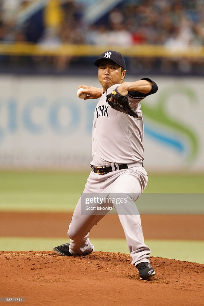 Hiroki Kuroda of the New York Yankees pitches during the first inning against the Tampa Bay Rays at Tropicana Field on August 17 2014 in St...