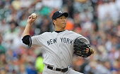 Hiroki Kuroda of the New York Yankees pitches during the game against the Detroit Tigers at Comerica Park on August 9 2012 in Detroit Michigan The...