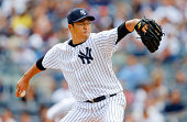 Hiroki Kuroda of the New York Yankees pitches in the first inning against the Chicago White Sox at Yankee Stadium on August 23 2014 in the Bronx...