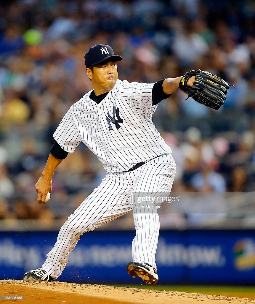 Hiroki Kuroda of the New York Yankees pitches in the third inning against the Detroit Tigers at Yankee Stadium on August 5 2014 in the Bronx borough...