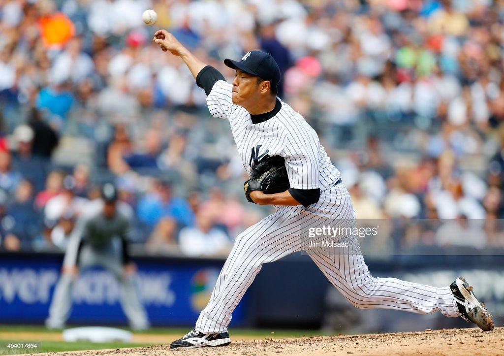 Hiroki Kuroda of the New York Yankees pitches in the third inning against the Chicago White Sox at Yankee Stadium on August 23 2014 in the Bronx...