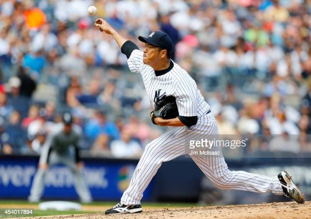 Hiroki Kuroda of the New York Yankees pitches in the third inning against the Chicago White Sox at Yankee Stadium on August 23 2014 in the Bronx...