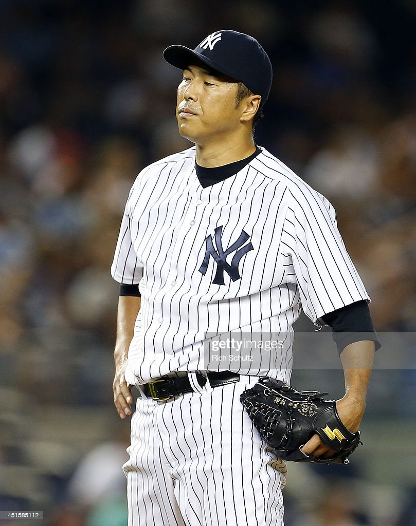 <a gi-track='captionPersonalityLinkClicked' href=/galleries/search?phrase=Hiroki+Kuroda&family=editorial&specificpeople=5498664 ng-click='$event.stopPropagation()'>Hiroki Kuroda</a> #18 of the New York Yankees reacts after giving up a home run to James Loney #21 of the Tampa Bay Rays during the sixth inning in a MLB baseball game at Yankee Stadium on July 1, 2014 in the Bronx borough of New York City.