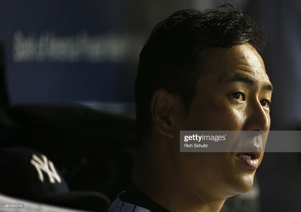 Hiroki Kuroda #18 of the New York Yankees sits in the dugout after the sixth inning in a game against the Tampa Bay Rays in a MLB baseball game at Yankee Stadium on July 1, 2014 in the Bronx borough of New York City. The Rays defeated the Yankees 2-1.