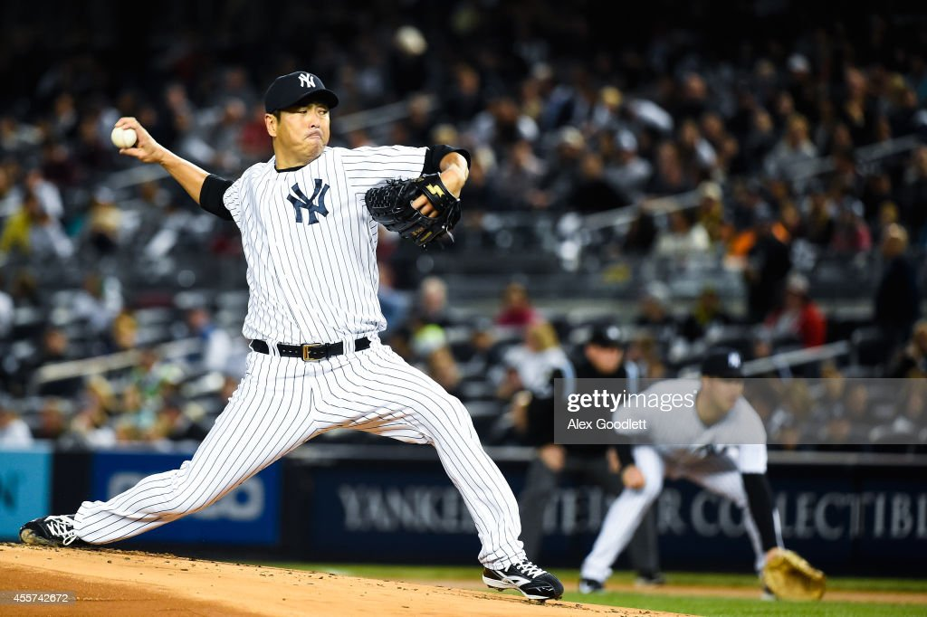 <a gi-track='captionPersonalityLinkClicked' href=/galleries/search?phrase=Hiroki+Kuroda&family=editorial&specificpeople=5498664 ng-click='$event.stopPropagation()'>Hiroki Kuroda</a> #18 of the New York Yankees throws a pitch in the first inning against the Toronto Blue Jays at Yankee Stadium on September 19, 2014 in the Bronx borough of New York City.