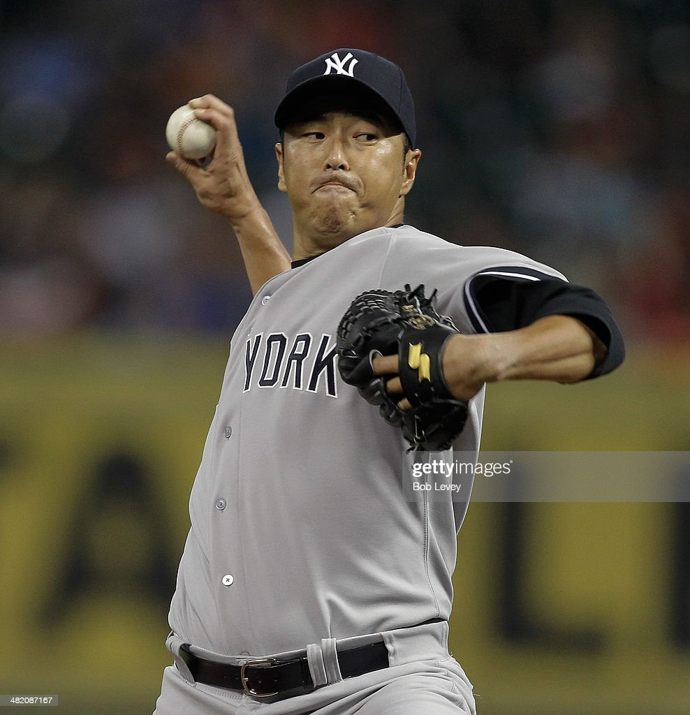 Hiroki Kuroda of the New York Yankees throws in the first inning against the Houston Astros at Minute Maid Park on April 2 2014 in Houston Texas
