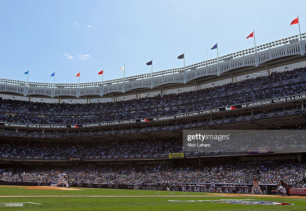 <a gi-track='captionPersonalityLinkClicked' href=/galleries/search?phrase=Hiroki+Kuroda&family=editorial&specificpeople=5498664 ng-click='$event.stopPropagation()'>Hiroki Kuroda</a> #18 of the New York Yankees throws the first pitch of thhe game against <a gi-track='captionPersonalityLinkClicked' href=/galleries/search?phrase=Erick+Aybar&family=editorial&specificpeople=551376 ng-click='$event.stopPropagation()'>Erick Aybar</a> #2 of the Los Angeles Angels during the home opener at Yankee Stadium on April 13, 2012 in the Bronx borough of New York City.