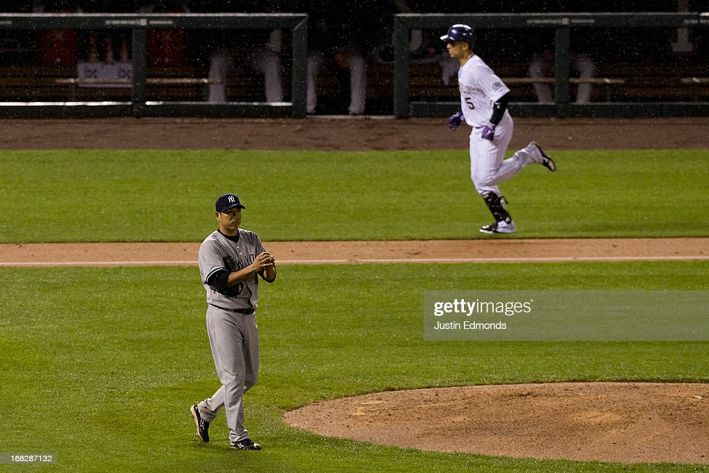 Hiroki Kuroda #18 of the New York Yankees walks around the mound after giving up a two-run home run to Carlos Gonzalez #5 of the Colorado Rockies during the sixth inning at Coors Field on May 7, 2013 in Denver, Colorado. The Rockies defeated the Yankees 2-0.