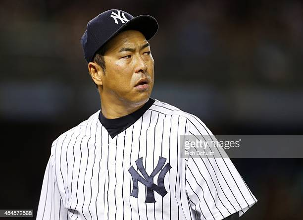 Hiroki Kuroda of the New York Yankees walks off the mound in the sixth inning against the Boston Red Sox in a MLB baseball game at Yankee Stadium on...