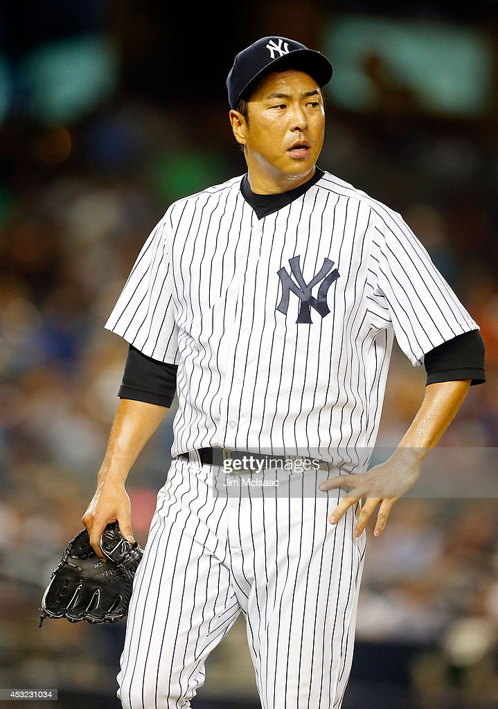 Hiroki Kuroda of the New York Yankees walks to the dugout after the seventh inning against the Detroit Tigers at Yankee Stadium on August 5 2014 in...