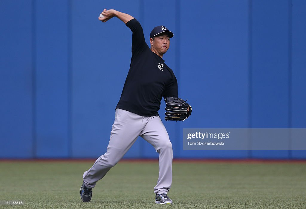 <a gi-track='captionPersonalityLinkClicked' href=/galleries/search?phrase=Hiroki+Kuroda&family=editorial&specificpeople=5498664 ng-click='$event.stopPropagation()'>Hiroki Kuroda</a> #18 of the New York Yankees warms up before the start of MLB game action against the Toronto Blue Jays on August 31, 2014 at Rogers Centre in Toronto, Ontario, Canada.