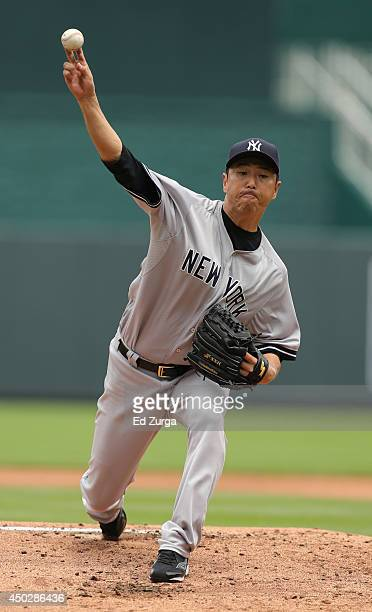 Hiroki Kuroda of the New York Yankees warms up between innings in the first inning during a game against the Kansas City Royals at Kauffman Stadium...