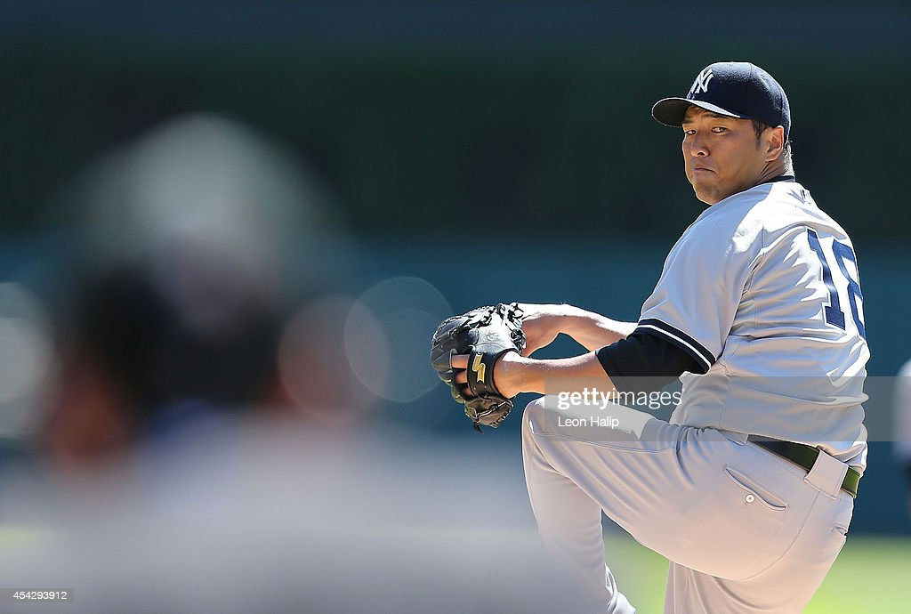 Hiroki Kuroda of the New York Yankess warms up prior to the start oif the first inning of the game against the Detroit Tigers at Comerica Park on...